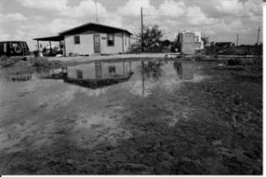 A home in a flooded Texas colonia