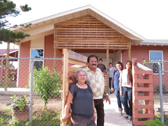 The Delgado family outside their new home. All photos courtesy of CDCB.