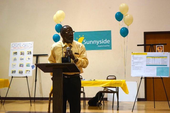 Rev. Henry Price, one of the leaders of the Sunnyside Plan, speaks at the event.