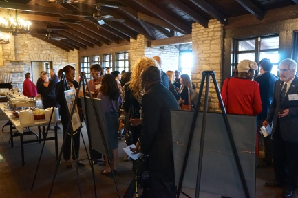 Attendees gather inside the Zilker Park Clubhouse before the event.